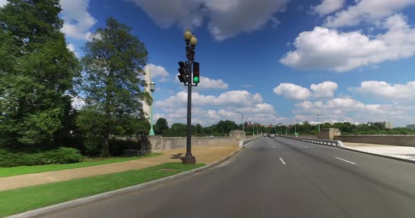 A forward perspective driving on Independence Avenue near the Washington Monument in DC on a sunny summer day.   Royalty-free stock video