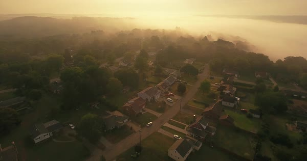 An early foggy morning reverse aerial establishing shot of a typical Western Pennsylvania residential neighborhood. Pittsburgh suburb.   Royalty-free stock video