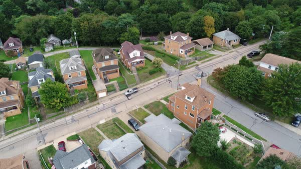 A slowly moving forward aerial view of a typical western Pennsylvania residential neighborhood corner.  Royalty-free stock video