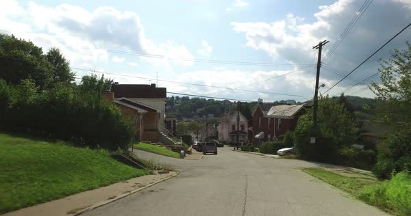 A rear driving plate on the streets in Pittsburgh's West End residential neighborhood. Royalty-free stock video