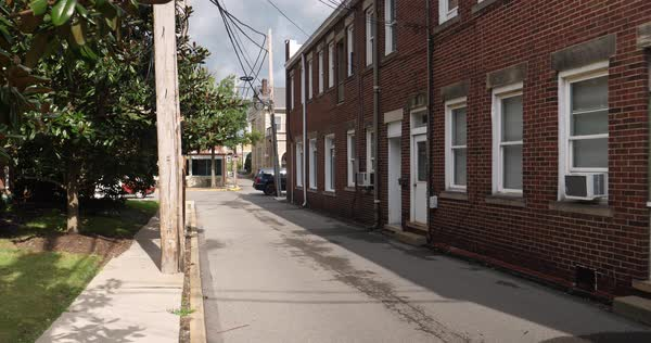 A daytime establishing shot of an empty alleyway in a small town in America.   Royalty-free stock video