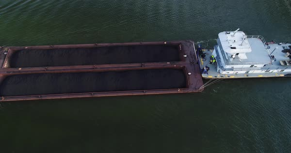 A top down aerial view of a coal barge traveling on the Ohio River.  Royalty-free stock video