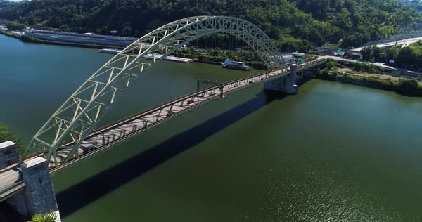 A slow reverse motion establishing shot of Pittsburgh's West End Bridge over the Ohio River.  	 Royalty-free stock video