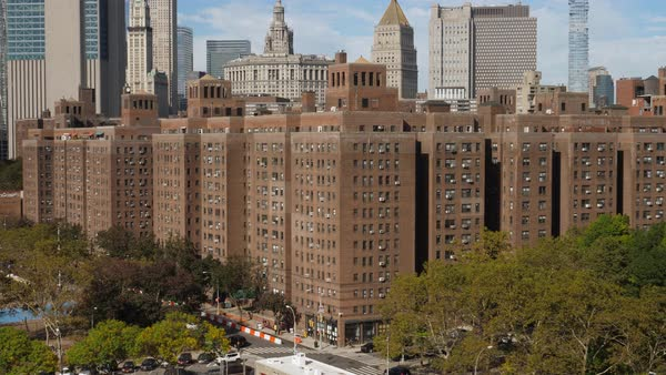 A daytime sunny exterior establishing shot (DX) of typical red brick apartment buildings in the Two Bridges neighborhood in midtown Manhattan.   Royalty-free stock video