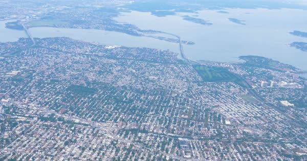 A high angle aerial view of New York City's Queens borough.  Royalty-free stock video