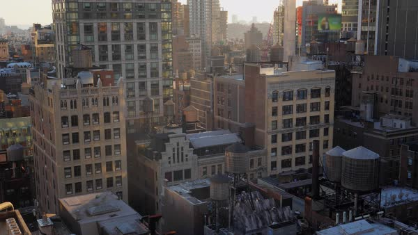 A high angle view of typical midtown Manhattan office and apartment buildings at sunset or morning.   Royalty-free stock video