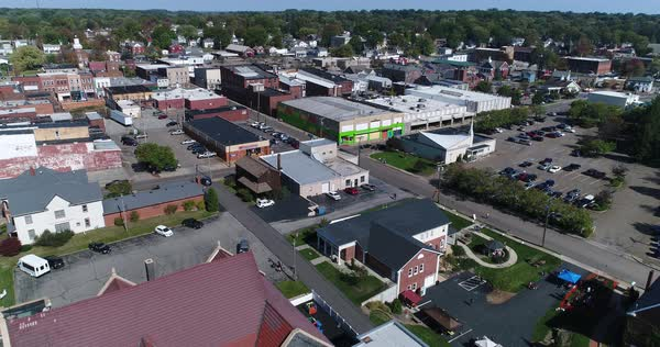 A day slow forward aerial establishing shot of the small town of Salem, Ohio's business district.   Royalty-free stock video