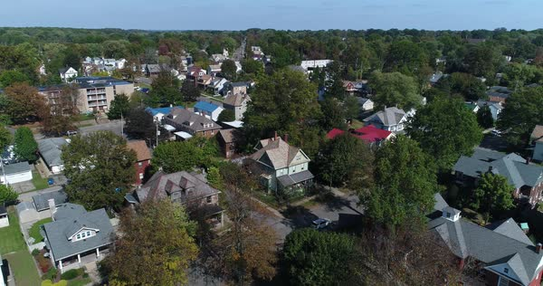A daytime slow reverse aerial establishing shot of a residential neighborhood in Salem, Ohio.   Royalty-free stock video