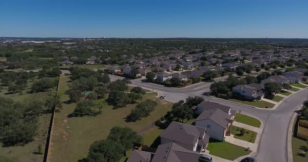 A day high angle aerial establishing shot of a typical San Antonio, Texas residential neighborhood.   Royalty-free stock video