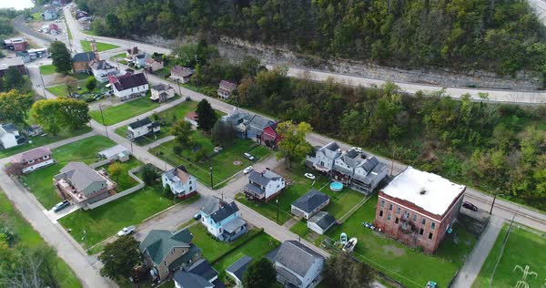 A daytime forward aerial establishing shot of a residential neighborhood of Brownsville, Pennsylvania - a Pittsburgh suburb.   Royalty-free stock video