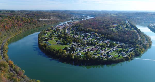 A high angle slow push forward establishing shot of the small mill town of Newell, Pennsylvania nestled on a bend of the Monongahela River just south of Pittsburgh, PA.   Royalty-free stock video