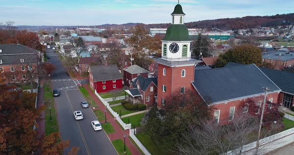 A slow forward aerial establishing shot of a small American town in the late Autumn.  Royalty-free stock video
