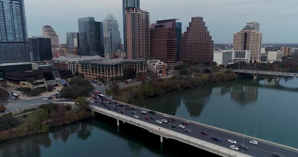 An aerial establishing shot of traffic passing over the South 1st Street Bridge over the Colorado River in Austin, Texas.   Royalty-free stock video