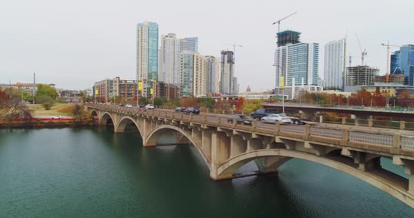 A daytime overcast aerial view of traffic flowing over the S Lamar Boulevard bridge in downtown Austin, Texas on an overcast winter's day.   Royalty-free stock video