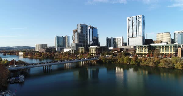A slow aerial push forward of the Austin, Texas skyline on an early Autumn evening. The Colorado River in the foreground.   Royalty-free stock video