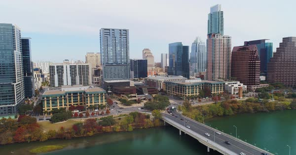 A slowly rising and tilt down of the Austin, Texas city skyline on a late Fall overcast day. The Colorado River is in the foreground.   Royalty-free stock video