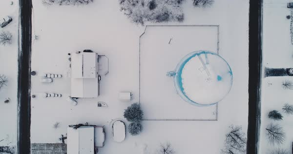 A bird's eye aerial view looking straight down on snow covers houses and rooftops in a typical Pennsylvania residential neighborhood. Pittsburgh suburbs. Royalty-free stock video