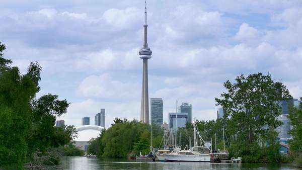TORONTO, ONTARIO, CANADA - Circa June, 2014 - Passing by a marina on Toronto Island with the CN Tower in the background. Royalty-free stock video