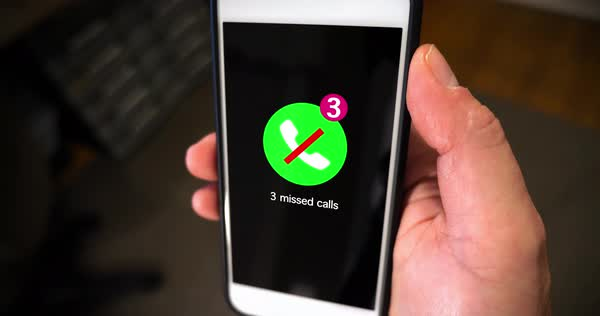 A man holds a smartphone showing the notification of receiving three missed calls.   Royalty-free stock video