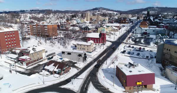A slow forward winter aerial shot of traffic patterns in the business district of Rochester, PA, a Pittsburgh suburb.  Royalty-free stock video