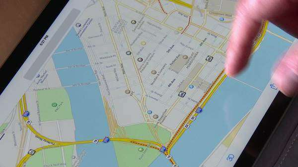 An unidentified man uses an Apple iPad Air to examine a map of Pittsburgh, Pennsylvania. Royalty-free stock video