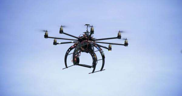 An unmanned drone flies overhead. Royalty-free stock video