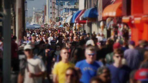 VENICE BEACH, CA - Circa February, 2015 - Slow motion crowd of people on the famous Venice Beach Boardwalk. Royalty-free stock video