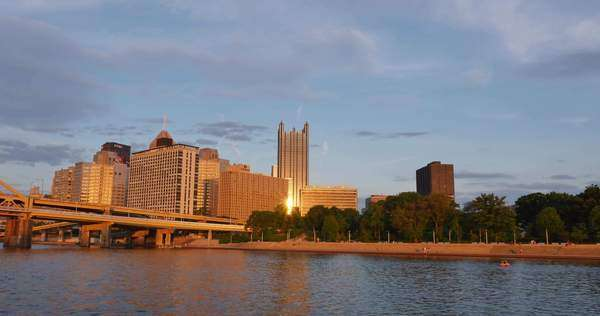 PITTSBURGH, PA - Circa May, 2015 - An early evening establishing shot of the skyline of Pittsburgh, Pennsylvania.  As seen from the Monongahela River. Royalty-free stock video