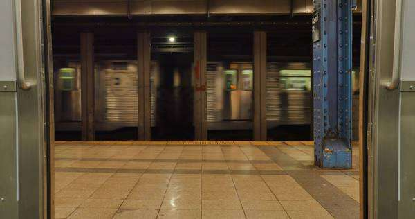 A low angle view of the doors of a New York subway car opening. Royalty-free stock video