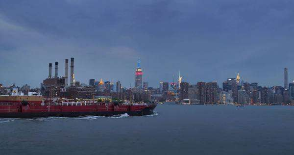 NEW YORK CITY - June, 2015 - An evening establishing shot of the skyline of Manhattan as seen from the East River. Royalty-free stock video