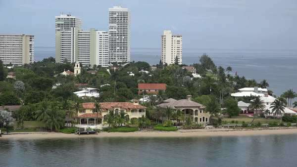 High rise buildings rise above shady parks and elegant mansions in Fort Lauderdale, Florida. Royalty-free stock video