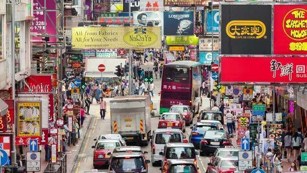 Hong Kong, China - Jun 2, 2015: timelapse video of pedestrians and traffic in a busy street in Mongkok, which is a popular travel destination in Hong Kong. Royalty-free stock video