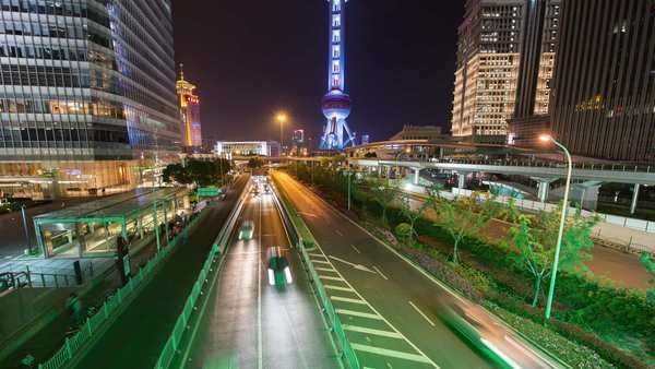 Tilt freeway and busy Pudong city center. With Pearl Tower light show. Rights-managed stock video