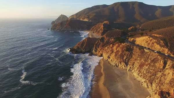 Aerial footage of Bay Area Coastlne Highway 1 during sunset. Rights-managed stock video