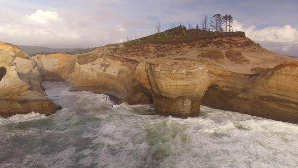 Aerial shot of sea stack along Cape Kiwanda on the Oregon coast. Rights-managed stock video