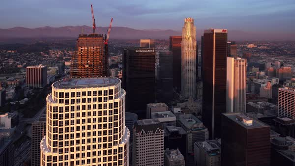 Downtown Los Angeles cityscape aerial, pullback. Rights-managed stock video