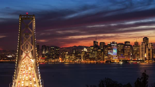 Bay Bridge at sunset, San Francisco timelapse. Rights-managed stock video