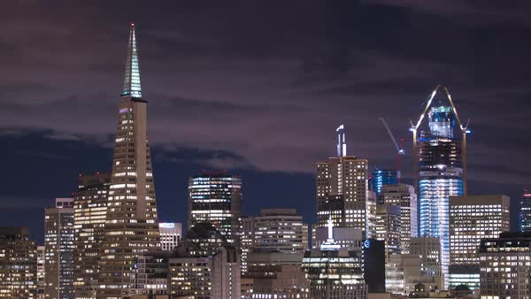 Urban city lights flickering, San Francisco timelapse. Rights-managed stock video