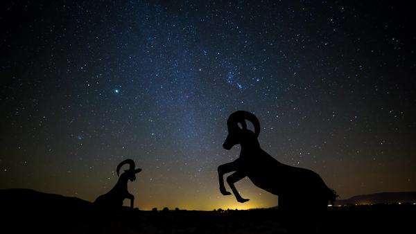 Timelapse dolly shot of Statues in the Anza Borrego Desert with stars and Orion. Rights-managed stock video