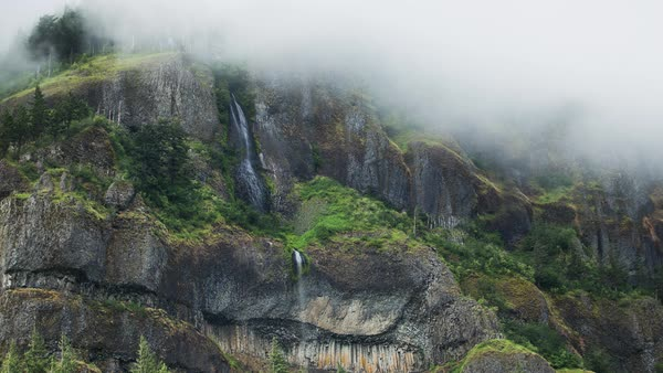Foggy waterfall timelapse taken in the Columbia Gorge, Oregon. Rights-managed stock video