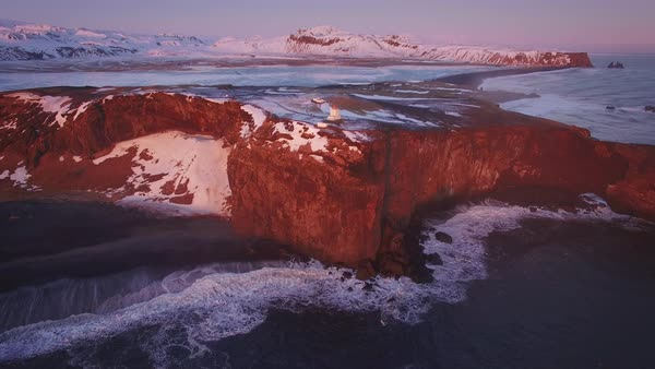 Iceland Aerial Dyrholaey Sunset Pull Back Rights-managed stock video