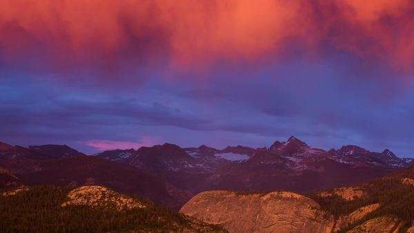 Timelapse static shot of Eastern Sierras during a vivid stormy sunset. Rights-managed stock video