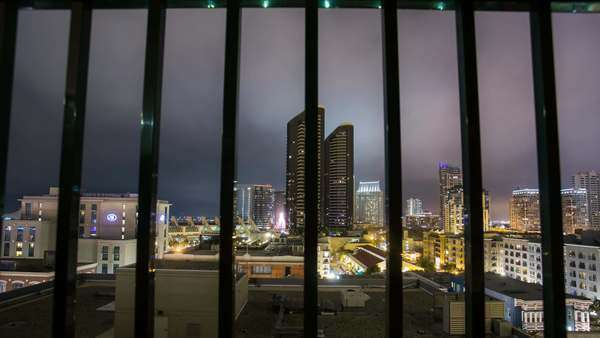 Timelapse dolly shot of San Diego Downtown over railing cityscape. Rights-managed stock video