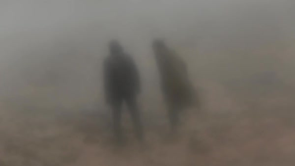 Out of focus shot of two persons standing in fog Royalty-free stock video