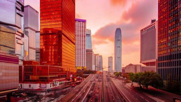 Sunset to night timelapse of the Admiralty business district in Hong Kong. Dramatic clouds are reflected on the skyscrapers' facades at Connaught Road Central. Royalty-free stock video