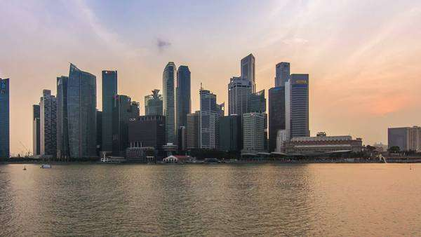 Singapore, Singapore 30/08/2015: Singapore skyline cityscape day to night timelapse,sunset over financial district bay view city lighting up zoom out Royalty-free stock video
