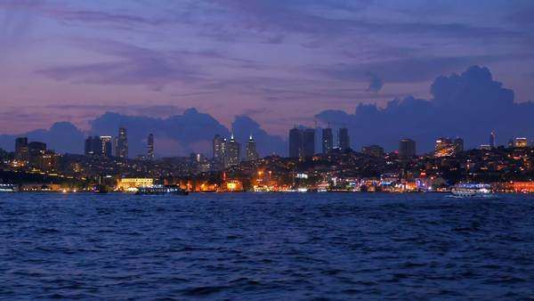 Istanbul, Turkey: Cityscape illuminated at night: Financial center as seen from the Bosphorus Sea Royalty-free stock video