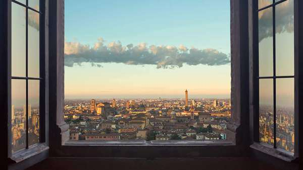 Bologna cityscape as seen from behind a window day to night timelapse Royalty-free stock video