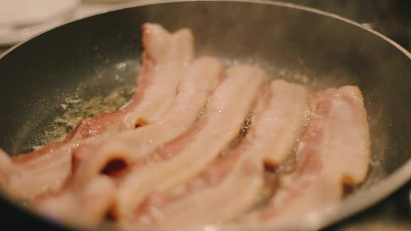 Cooking Bacon in the Kitchen Royalty-free stock video
