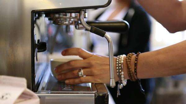 Profile shot of a womans hands making a latte from beginning to end Royalty-free stock video